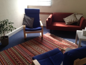 Spacious therapy room with an analytic couch.